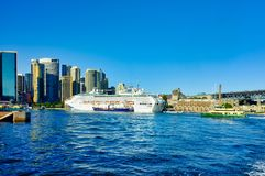 Large White Cruise Ship Docked in Circular Quay, Sydney, Australia. A large white modern cruise ship docked at the International Departures Terminal, Circular stock images