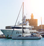 Large white modern motor superyacht in port city of Rhodes Greece. Large white modern motor superyacht in the port city of Rhodes Greece Royalty Free Stock Photography
