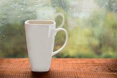 Large white mug on the window Stock Image