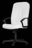 Large white office chair isolated on black. A large white office chair isolated on black background Royalty Free Stock Photo