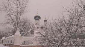 Large white Orthodox Church with Golden Orthodox crosses on the domes. General plan. stock video footage