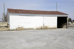 Large white painted garage with rusty roof Stock Photos