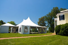 Large white party tent. Set up on a front lawn of a large mansion for a wedding Royalty Free Stock Photos