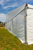 Large white party tent if a field Royalty Free Stock Photography
