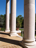 Large white porch columns. Three large white classical columns Stock Photo