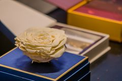 Large white rose made of white cocolate. Seoul, South Korea, January, 19, 2018: Large white rose made of white cocolate on display at the Seoul Salon of Stock Photo