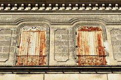 Large white and rusty closed window metal shutters Royalty Free Stock Image