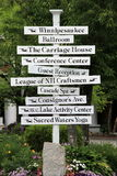 Large white sign post with directions around town,Lake Winnipesaukee,Summer,2014 Royalty Free Stock Photos
