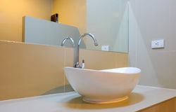 Large white sink with glass in the bathroom. Stock Photos