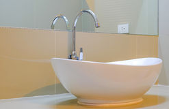 Large white sink with glass in the bathroom. Stock Images