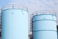 Large white tanks for petrol and oil Stock Image