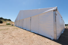 Large white tent for entertaining in field. A large white tent in a grass field for parties and entertaining Stock Photo
