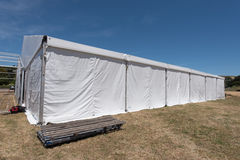 Large white tent for entertaining in field. A large white tent in a grass field for parties and entertaining Royalty Free Stock Photography