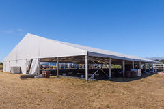 Large white tent for entertaining in field. A large white tent in a grass field for parties and enteraining Stock Photography
