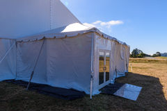 Large white tent for entertaining in field. A large white tent in a grass field for parties and enteraining Stock Image