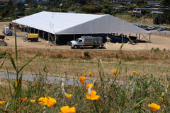 Large white tent for entertaining in field. A large white tent in a grass field for parties and enteraining Royalty Free Stock Images