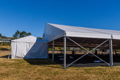 Large white tent for entertaining in field. A large white tent in a grass field for parties and enteraining Royalty Free Stock Photo