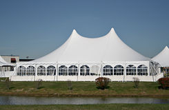 Large white tent used for gatherings. Full frame image of a large white tent that is used for parties, weddings and other gatherings royalty free stock photography