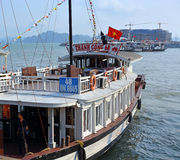 Large White Tourist Boat Departs Halong Bay Marina Royalty Free Stock Image