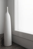 Large white vase ornament sculpture next to large window. In a luxury home royalty free stock photography