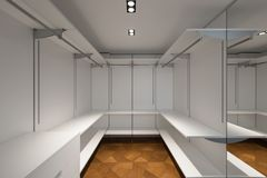 Large white walk-in closet with parquet. Nobody inside, copy space stock images