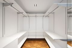 Large white walk-in closet with parquet. Nobody inside, copy space royalty free stock photos