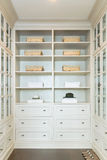 Large white walk-in closet with shelves. At home stock photography