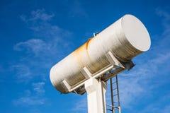 Large white water storage tank. Royalty Free Stock Photos