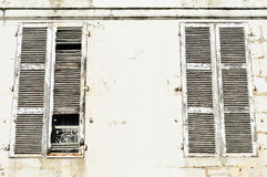 Large white weathered closed wooden window shutters Royalty Free Stock Photos