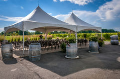 Large white wedding tent. A large white wedding tent set up for an outdoor ceremony  or banquet on a vineyard Stock Photos