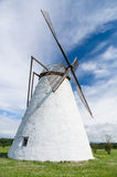 Large white windmill under blue sky Stock Photos