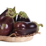 Large whole aubergines in a bowl isolated on white Royalty Free Stock Image