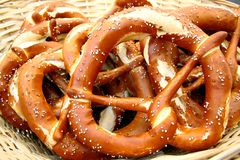 Large wicker basket and giant pretzels, close up Stock Image