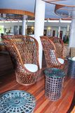 Large wicker chairs in the lobby Royalty Free Stock Image