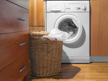 Large Wicker Laundry Basket, Open Lid Near the Washing Machine with Laundry. House Interior Laundry Room. Wood Interior Design.  stock images
