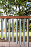 Large Wind Chimes in Park. Large wind chimes of tubular bells in a public park Stock Image