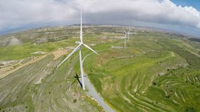 Large wind farm producing electricity for cities, alternative energy sources. Stock footage stock footage