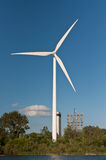 Large Wind Turbine with Trees and Blue Sky Royalty Free Stock Photo
