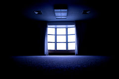 Large Window in Dark Room. Large dark room with bright light coming in through paned window royalty free stock photos