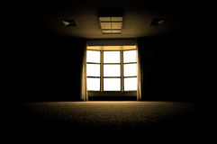 Large Window in Dark Room. Large dark room with bright light coming in through paned window royalty free stock photo