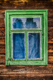 Large window in old wooden hut Stock Image