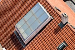 Large window on the roof. Of a historic house in downtown royalty free stock photography