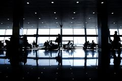 Large window seat resting black white silhouette sun passengers waiting gate terminal airport royalty free stock images