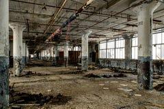 Large Windows & Columns - Abandoned National Acme Factory - Cleveland, Ohio. Large windows and concrete columns at the abandoned National Acme Factory in royalty free stock image