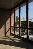 Large windows with light and shadow on brick wall Stock Photos