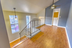 Large windows and wooden floors in spacious loft. Top story loft in Southern California townhome Stock Photography