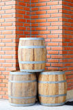 Large wine barrels. On Red brick wall Royalty Free Stock Images