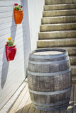 Large wine cask. Wall mounted pot and a large wine cask stock photo