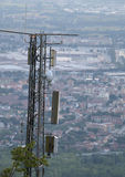 Large wireless telecommunications antenna over the metropolis Stock Images