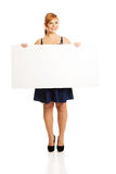 Large woman holding a white board Royalty Free Stock Images